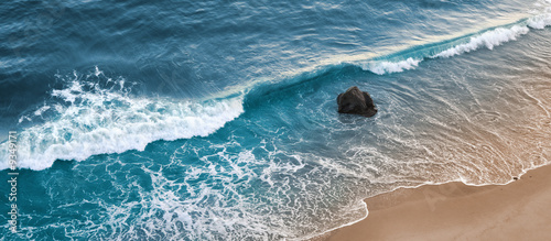 Photo A wave breaking on a beach in central California.