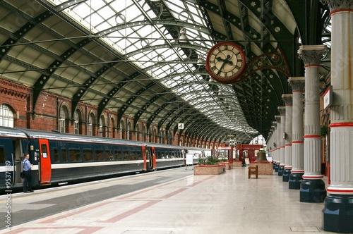 Platform in a railway station Fototapeta