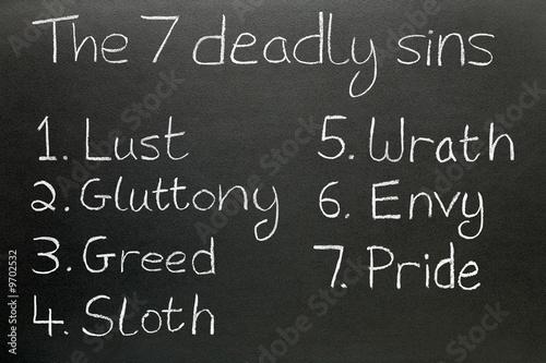 Carta da parati The seven deadly sins, written in chalk on a blackboard.