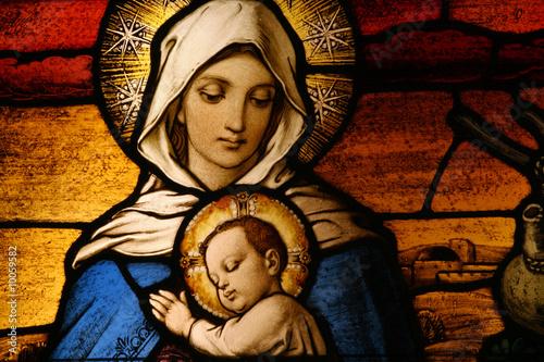 Obraz na plátně Stained glass depicting the Virgin Mary holding baby Jesus