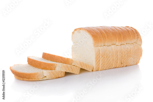 Stampa su Tela Sliced loaf of bread isolated on white background