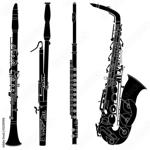 Woodwind musical instruments in vector silhouette Fototapeta