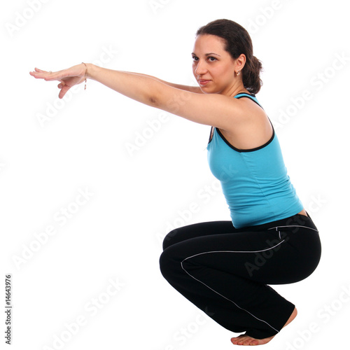 Brunet sport girl doing curtsey sideview Fototapeta