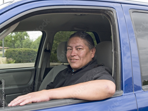 Wallpaper Mural Native American man in his car