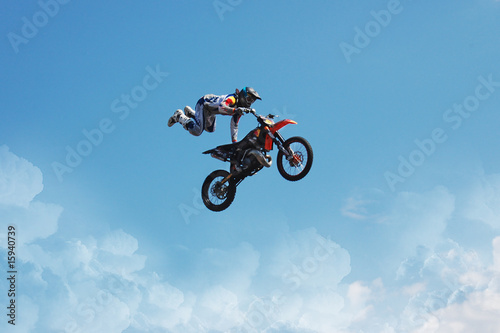 the man on the motorcycle jumping in the sky