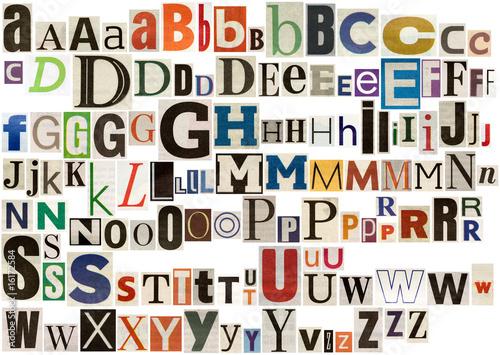 Obraz na plátně Colorful newspaper alphabet isolated on white