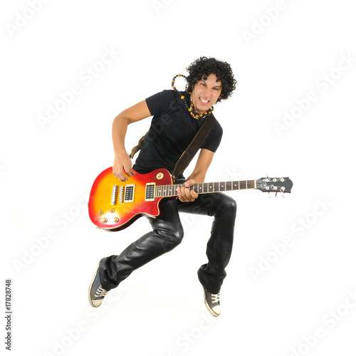 Obraz na plátně Young guitarist jumping isolated