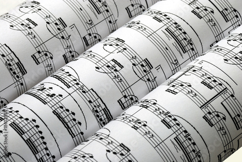 Three music sheets on a row isolated in white Fotobehang