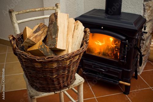 Obraz na plátne Logs in front of a stove
