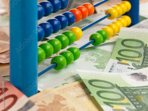 colored child abacus on money fond