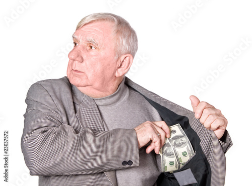 Fotografia Elderly man puts money in an internal pocket of a jacket
