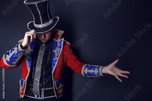 Billede på lærred Man in expensive suit of illusionist-conjurer.