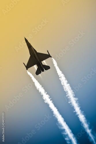 Canvas Print military jet aerobatics into an abstract gradient sky