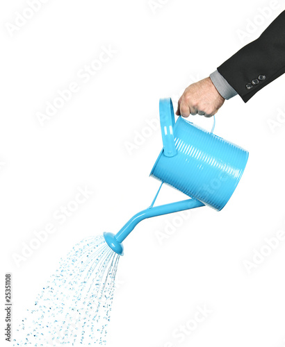 Obraz na plátně Hand pouring water from watering can
