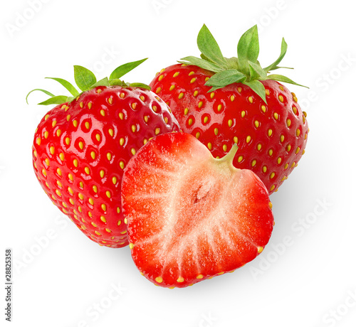 Isolated strawberries. Three strawberry fruits, one cut in half isolated on white background