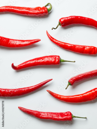 Photo red chilies on white background