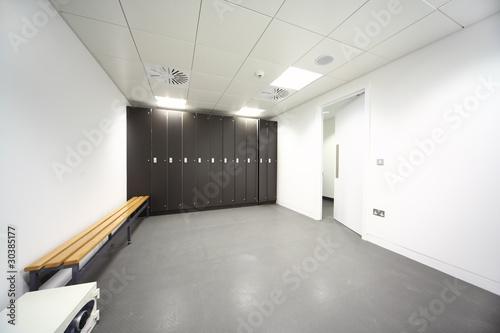 large clean room, gray floor and ceiling, black closet, bench Fototapeta