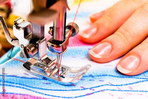 Obraz na plátne Hand sewing on a machine