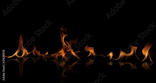 Fire wall with reflection on black background #31638938