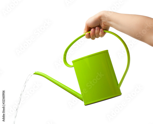 Canvas Print hand holding watering can isolated on white