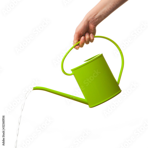 Fototapeta hand holding watering can isolated