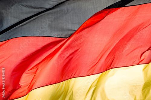 Wallpaper Mural german flag in the wind