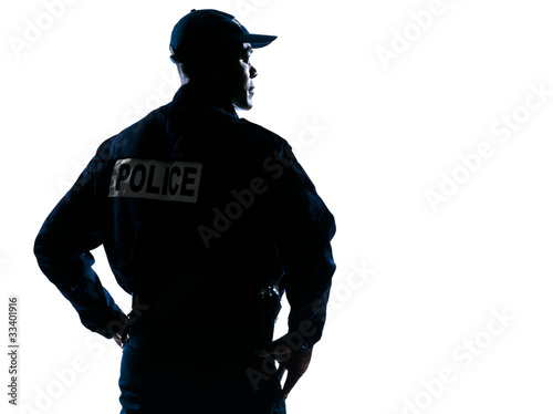 Photo Serious policeman with looking to his side
