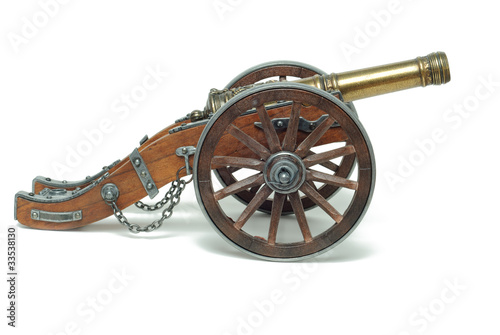 Fototapeta Ancient cannon on wheels isolated on white