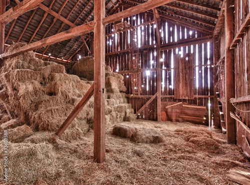 Interior of old barn with straw bales Poster Mural XXL