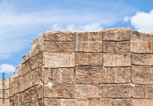 Photo Concrete block wall with blue sky.