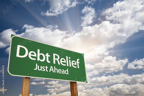 Billede på lærred Debt Relief Green Road Sign