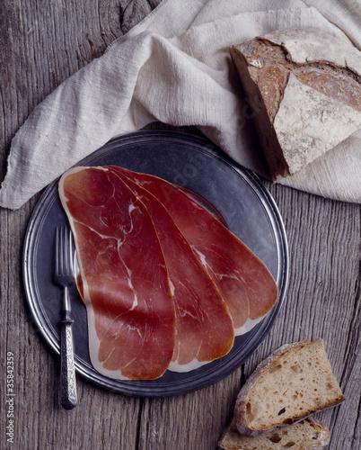 Slika na platnu Tranche de jambon de bayonne pain produit charcuterie