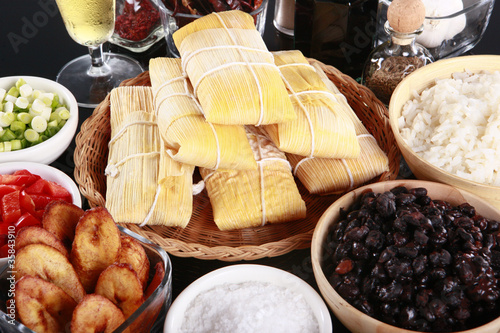 Staple latino sides, tamale, rice, plantains, and black beans