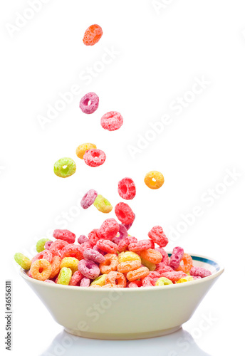 Wallpaper Mural Colorful cereal falling into a bowl  isolated on white