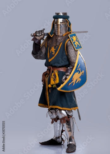 Medieval knight isolated on grey background. Fotobehang