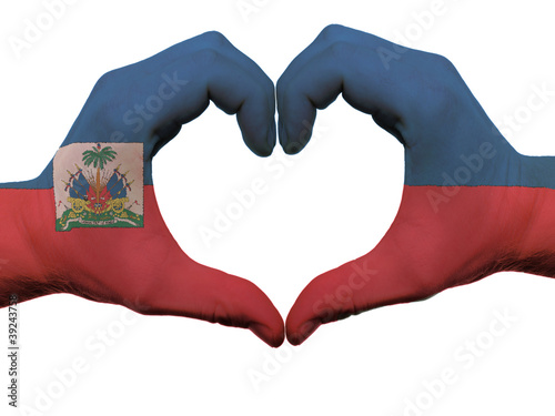 Fototapeta Heart and love gesture in haiti flag colors by hands isolated on