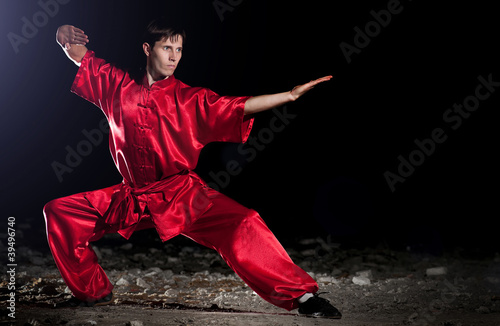 Canvas Print Wushoo man in red practice martial art