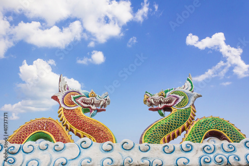 Chinese dragon statue on blue sky background