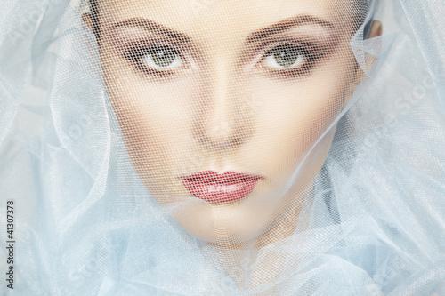 Fashion photo of beautiful women under blue veil Fototapeta