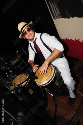 Fotografia, Obraz Cuban percussionist isolated on black