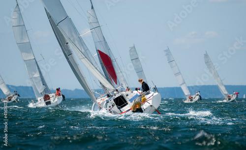 Photo group of yacht sailing at regatta