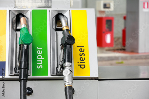 gasoline pump nozzles at petrol station Fototapet