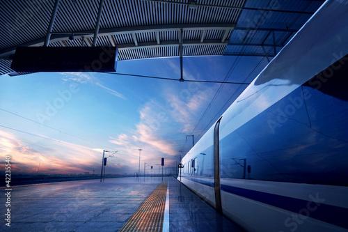 Obraz na plátně train stop at railway station with sunset