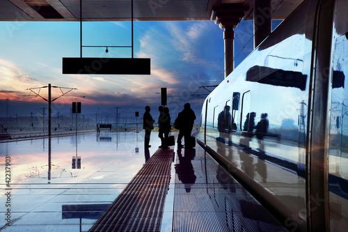 Obraz na płótnie train stop at railway station with sunset
