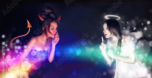 Portrait of angel and devil girls and copyspace between them. Fototapeta
