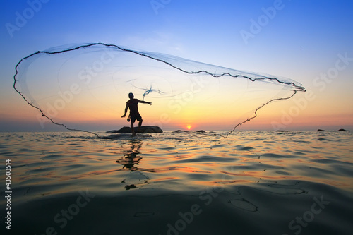 Canvas-taulu throwing fishing net during sunrise, Thailand
