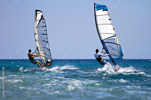 Two windsurfers in action