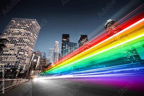 Αφίσα Colorful rainbow bus traffic blur in city