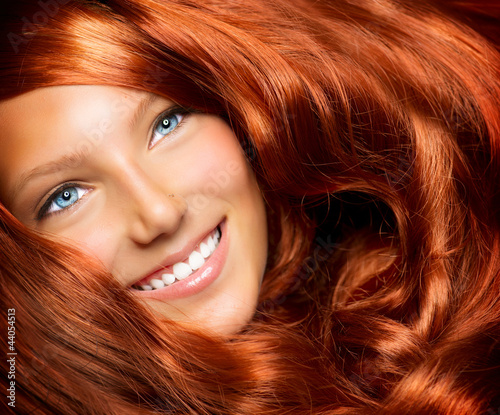 Beautiful Girl With Healthy Long Red Curly Hair