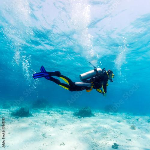 Wallpaper Mural Silhouette of Scuba Diver near Sea Bottom